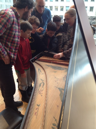 Charlotte Nediger showing students the harpsichord