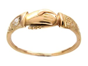 Georgian (18th century) wedding rings were popular from Roman times right up to the Victorian age, and were known as Fede Gimmal or Gimmel rings. 2 or 3 hoops would fit together like a puzzle, with 2 clasping hands.