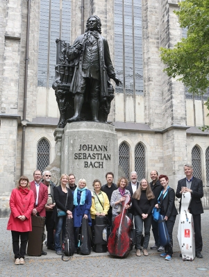 Tafelmusik Baroque Orchestra standing in from of the Bach statue outside St. Thomas's Church at the Bach Festival in Leipzig in 2014.