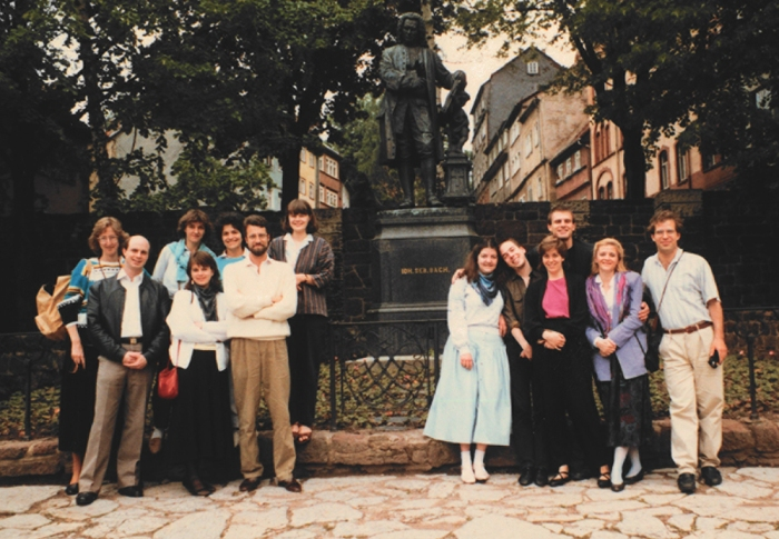 Members of Tafelmusik in front of the Bach statue in Eisenach, during tour of the former East Germany, spring 1987